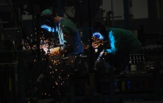 Welders at a factory