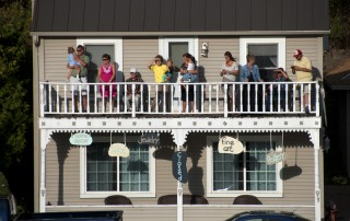 Folks in Alma, Wisconsin gather to watch the American Queen pass by