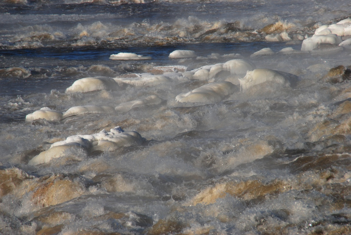 Close-up photograph of the Chain of Rocks rapids on the Mississippi River above St. Louis, with ice and steam all around them