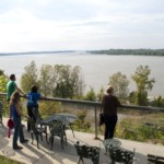 A group of people enjoy a panoramic view of the Mississippi River at Memphis